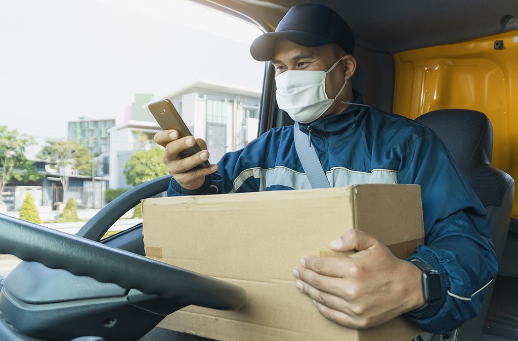 a delivery driver fulfiling eCommerce orders in his van